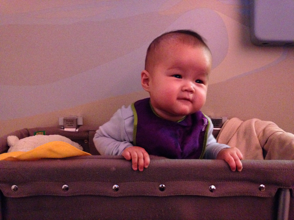 Kara having fun in her bulk head bassinet during our international flight to Dubai