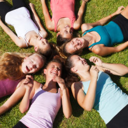 Circle of closed eyes teenage girls