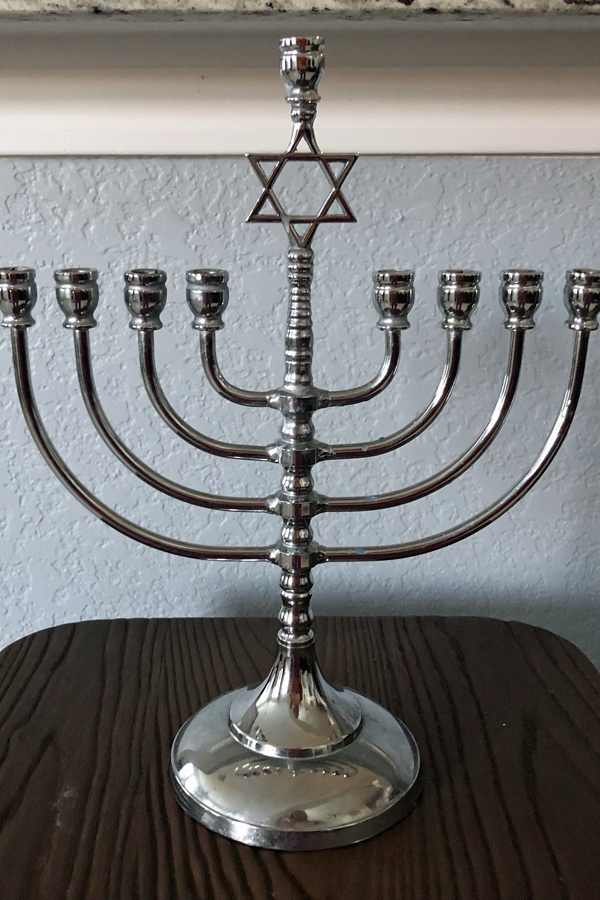 now jewish people all over the world light the hanukiah which has eight branches plus an extra candle holder for the shamash the helper candle - Do Jewish Celebrate Christmas