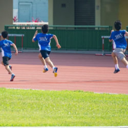 four-boys-running-in-track-2310482