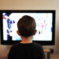 Canva - Kid Looking at a Television