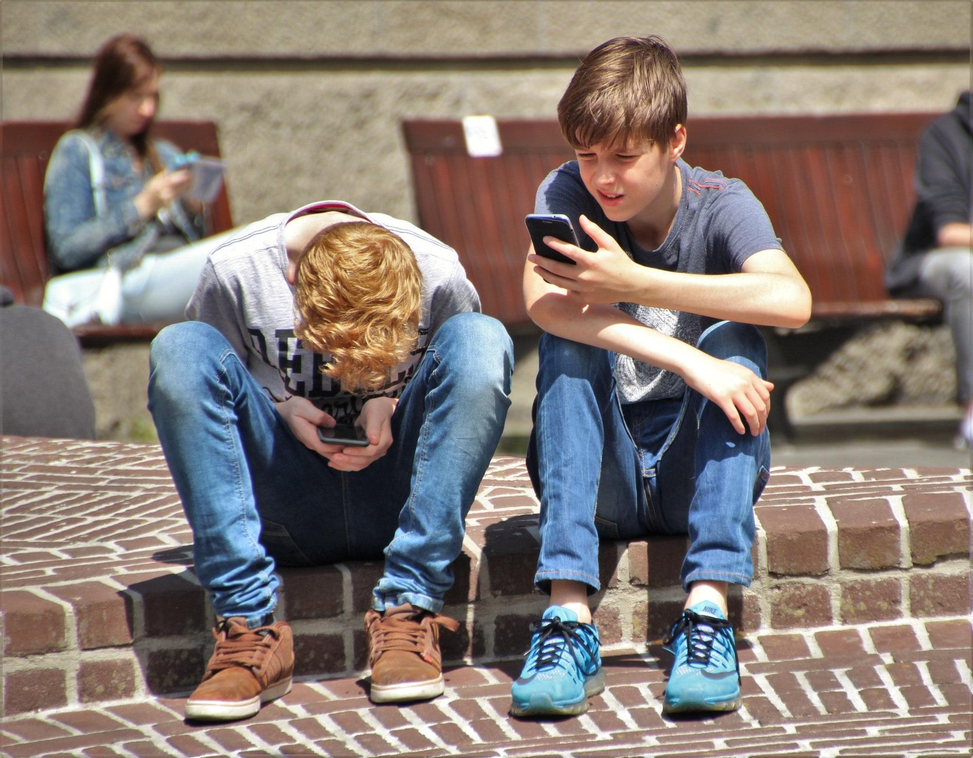 Teenagers looking at their phones