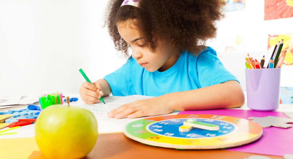 child writing letter to teacher