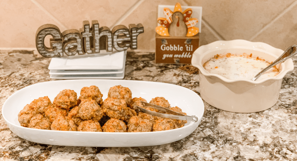 Thanksgiving appetizers sausage balls and a bowl of dip